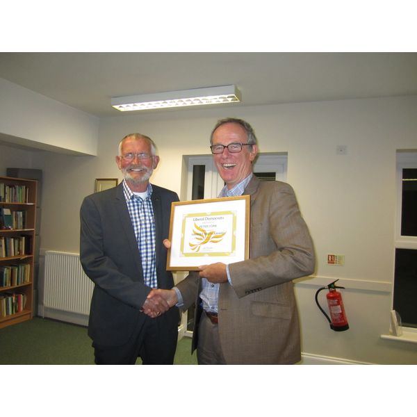 Liberal Democrat peer Lord Teverson presenting local Lib Dem Peter York with a Lifetime Achievement Award