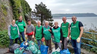 Plymouth Lib Dem chair Hugh Janes (4th from left) joins clean up on The Hoe ()