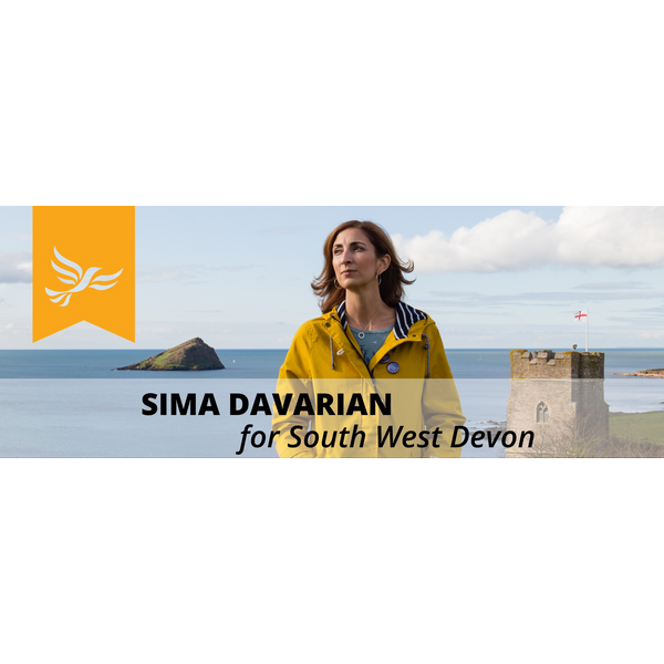 Photo of Sima Davarian on Plymouth sea front, Mew Stone in background (Sorcha Holloway 2019)